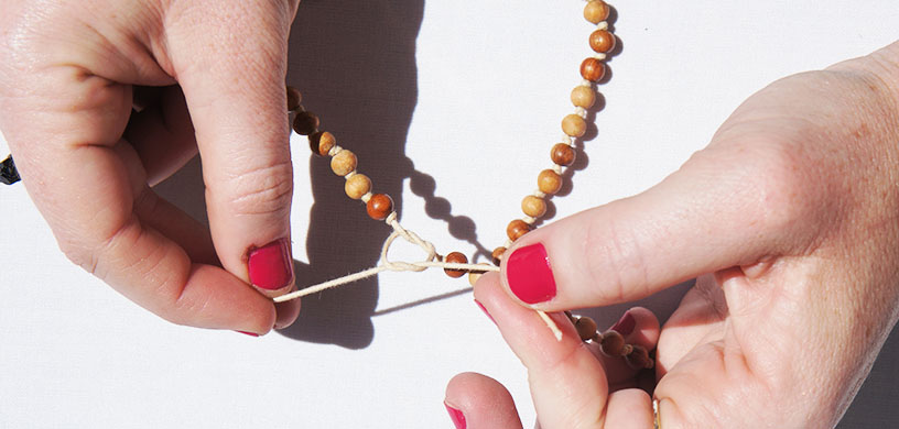 Tie the two ends of the mala together