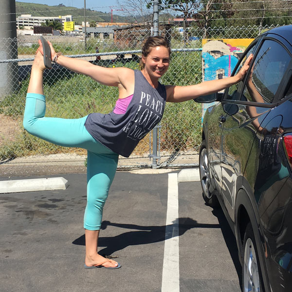 Yoga pose dancer next to a car