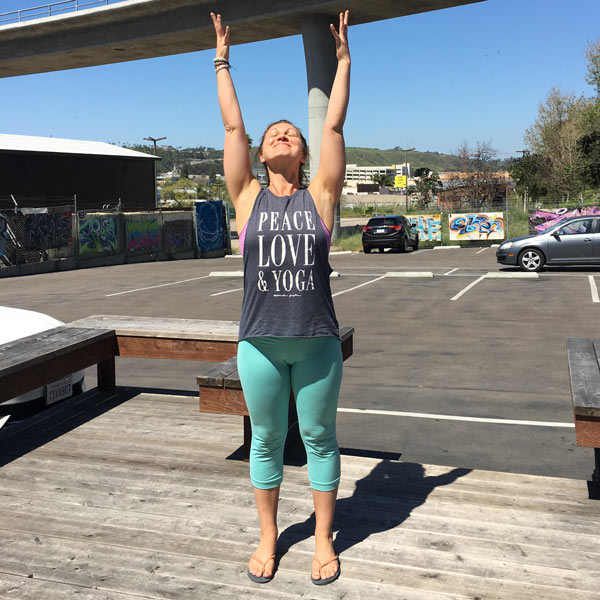 Yoga sun salutation on a road trip