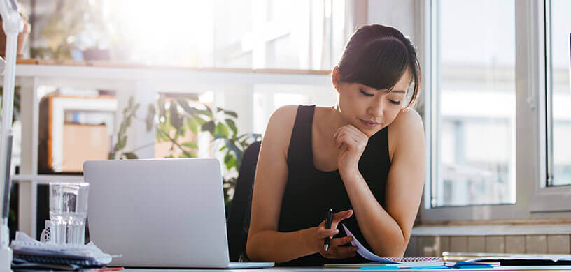 young woman creating new years resolution lists working on goals