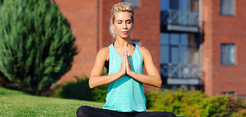 woman meditating outdoors beautiful sunny day