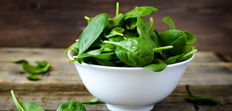 fresh spinach in white bowl
