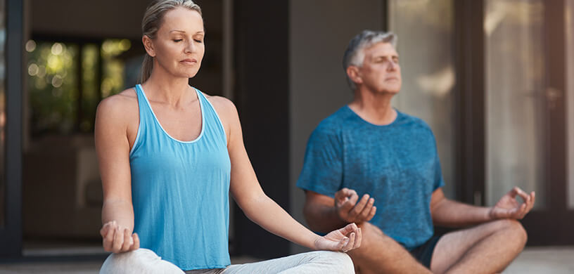 mature woman and man meditating