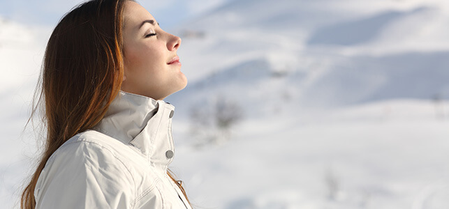 woman breathing in the cold