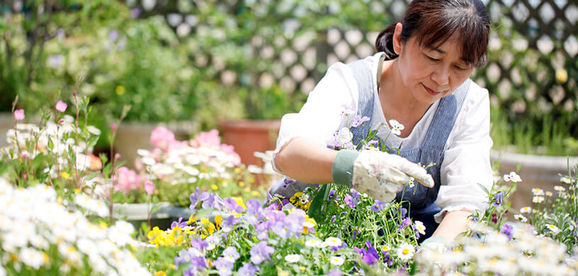 mature woman in her garden