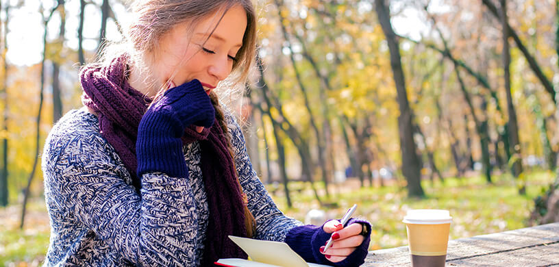 Woman Journaling outdoors