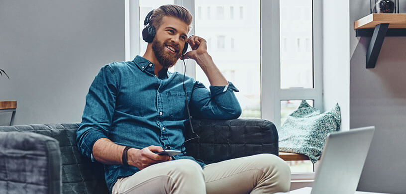Happy man listening to music at home