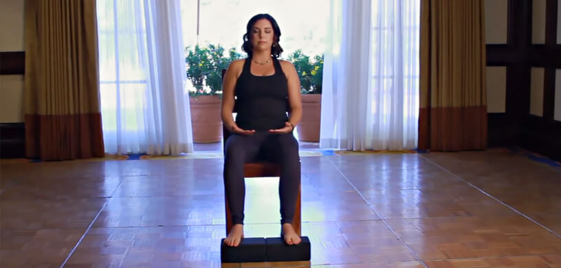 Woman doing chair yoga