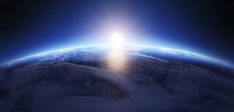 Sun rising over the planet Earth