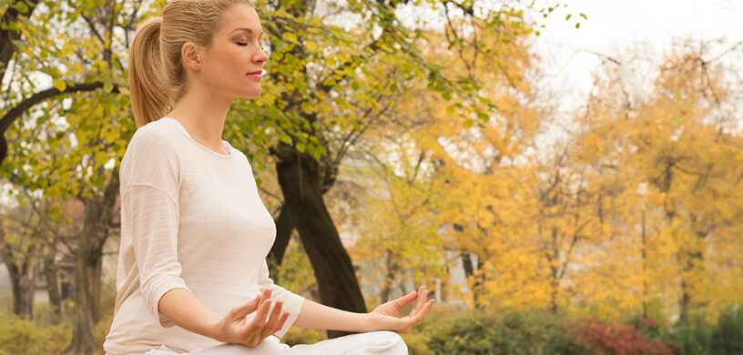 woman meditating fall outdoors