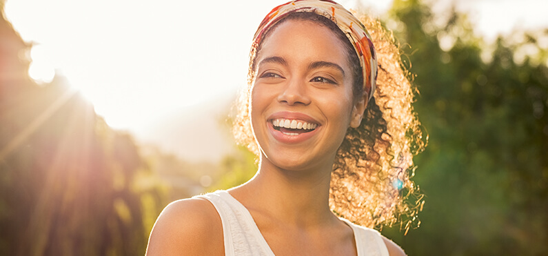 woman smiling sunset