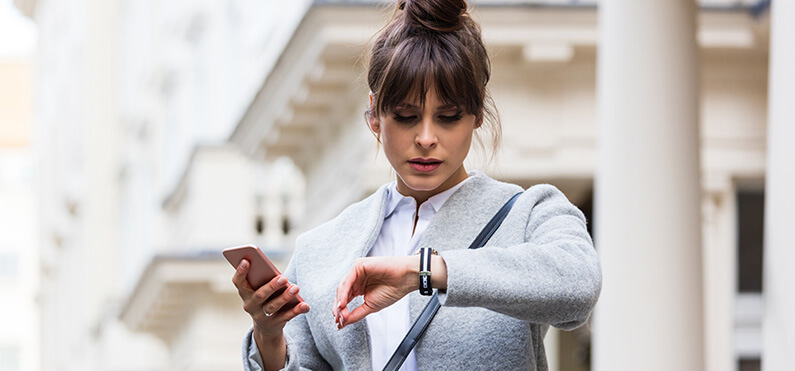 worried woman standing with phone