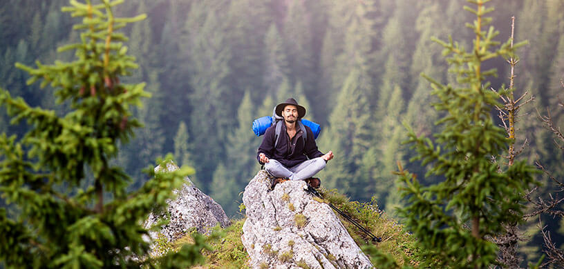 man hiking meditation in mountain
