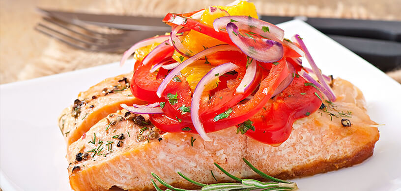 Roasted salmon with fresh peppers and onions