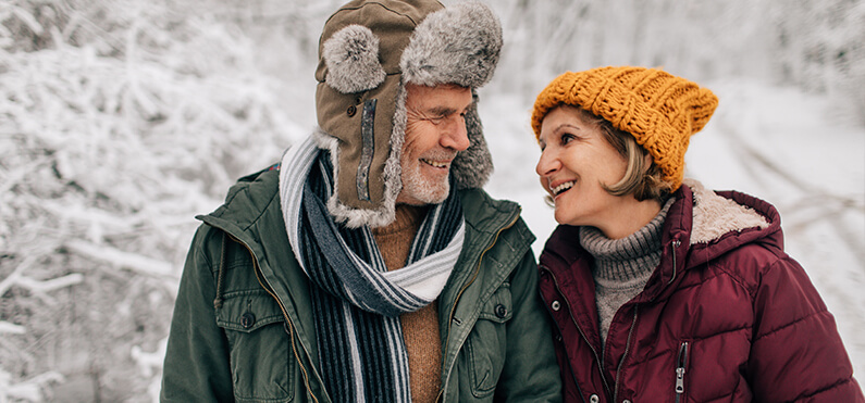 mature couple bundled for winter