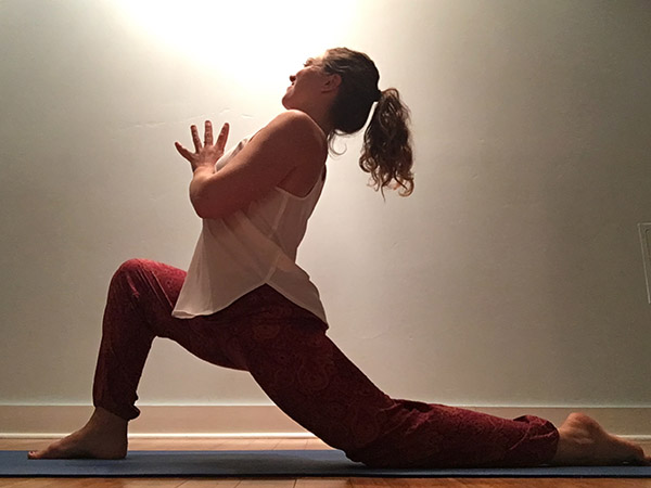 A yoga instructor in low lunge yoga pose
