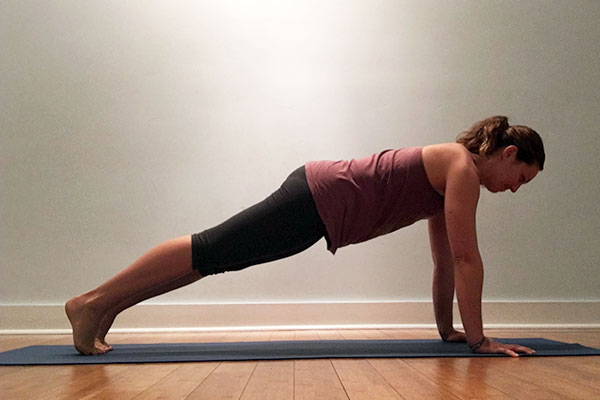 A yoga teacher in plank pose