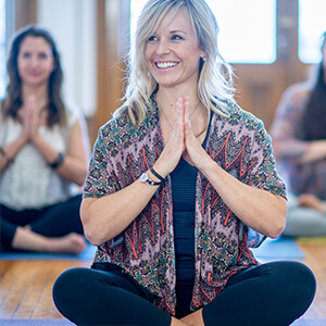 smiling woman meditation class